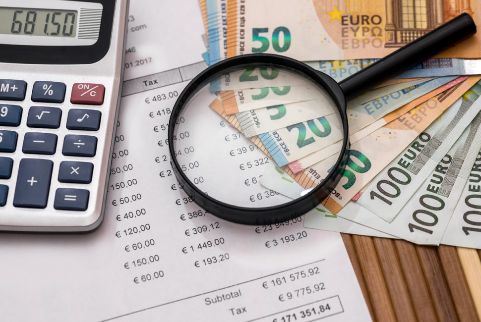 Purchase order with euro, magnifier and calculator