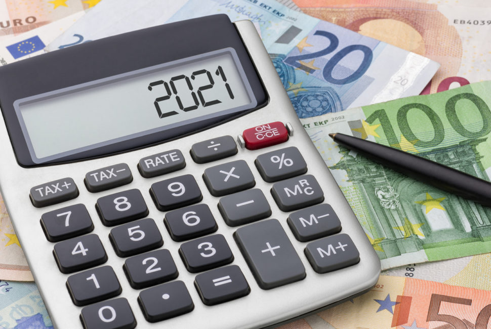 Calculator with money and a pen - 2021