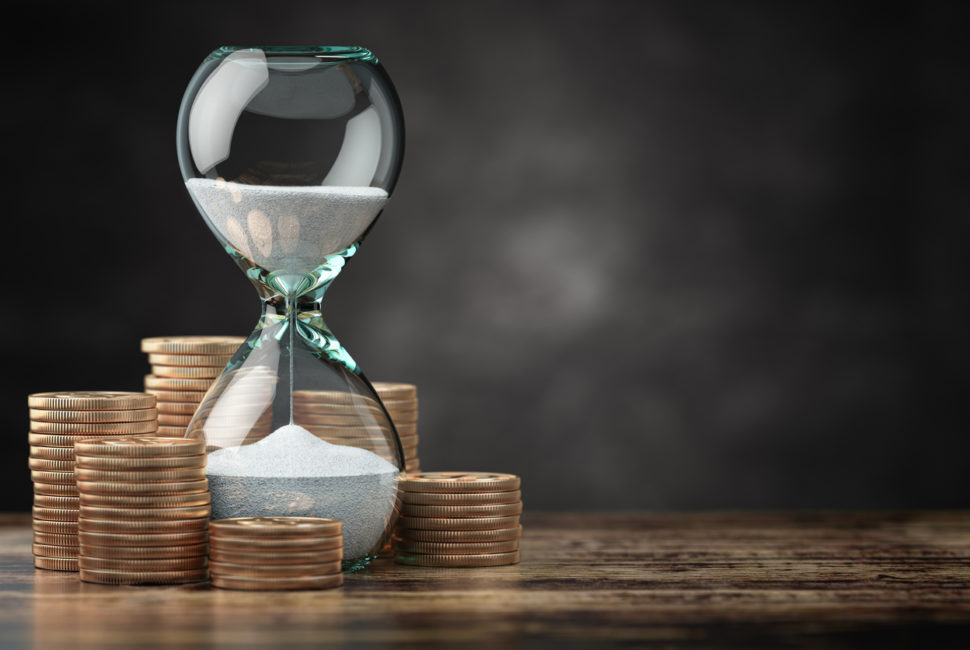 Golden coins and hourglass clock. Return on investment, deposit, growth of income and savings, time is money concept.